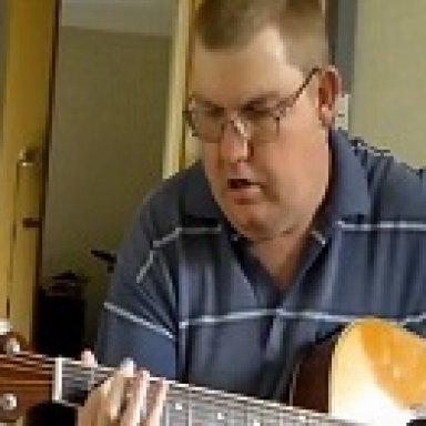 Milo on acoustic guitar